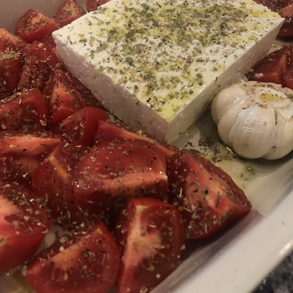 Feta, quartered tomatoes amd garlic for roasting